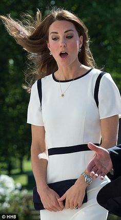 Surprise! The Duchess gasps as her carefully coiffed hair is blasted by a breeze...