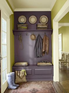 """Love this smoky hue. Benjamin Moore's """"Vintage Wine,"""" accent in """"Wasabi Green,"""" and white trim is called """"Hush."""""""