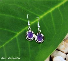 Earrings Titled Purple Haze by the Artist. This Item was SOLD