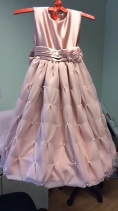 Flowergirl dress in pink satin and chiffon.