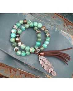 Genuine Natural Turquoise Beaded Bracelet looks great paired with a leather cuff! Accented with a tassel and copper feather. Although your bracelet will resemble the photo, each piece is created by hand, so no two are identical.