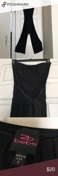 Stretch Black strapless Jumpsuit wide leg Black strapless jumpsuit, wide leg, tie waist for a sleek look and added comfort. In excellent condition. Worn once. This was tailored to fit a 5'1 person in 4 inch heels. First photo is a similar stock photo. 2B Bebe Pants Jumpsuits & Rompers