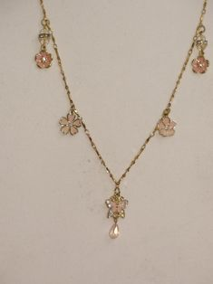 You are buying a gold chain with 4 little light pink flowers and 1 light pink butterfly pendants. The necklace measures 26 inches and has a 3 inches extension. Butterfly Pendant, Butterfly Necklace, Pink Butterfly, Light Pink Flowers, Little Flowers, Handmade Valentine Gifts, Valentine Day Gifts, Pink Aesthetic, Gold Chains