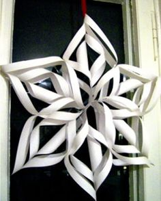 Ever wanted to make a snowflake out of paper? Yes? Here is your chance - using nothing but paper and scissors! Perfect for a Christmas decoration.