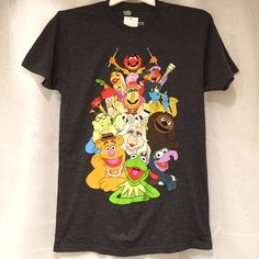 Disney The Muppets Grey Men's T-Shirt Brand new with tags, men's size Medium. This Disney The Muppets Grey Tee features Kermit, Ms. Piggy, Animal and more! Perfect for any Muppets fan! Disney Tops Tees - Short Sleeve