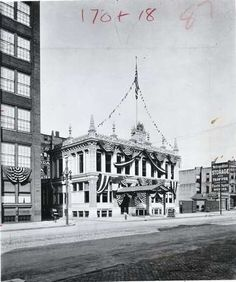 This is the main entrance to Kodak Office Building, on State Street, as it was on the day of dedication in 1899, fronted by a brick walk and stone pavement.