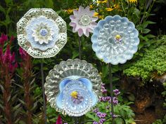 Learn how to make affordable glass flowers from recycled glass and dishes. These glass flowers make beautiful garden art and gifts!