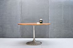 Yacht Teak Aluminum Dining Table 20th Century Vintage Industrial USA, c.1960s. Vintage Yachts Mast Teak and Aluminum Dining Table. Fluting Tulip Base Design, Solid Teak Table Surface, Biscuit Joints and Bullnose Edges. Heavy Wear and Patina to All Surfaces, though Fully Functional, Bottom Weighted with Leveling Glides.    Dia: 48 x H: 30 in.