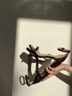 Combining functionality with unique attributes to add a twist to your wardrobe staple. Brown python sandal with a block heel and silver buckle. Italian Leather, Python, Hand Stitching, Wardrobe Staples, Block Heels, Detail, Sandals, Brown, Unique