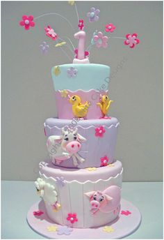 I like the wavy parts on the cake and the shape of the tiers... cute animals too!