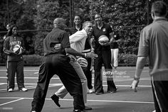 President Barack Obama plays basketball with former NBA player Bruce Bowen during the annual Easter Egg Roll on the South Lawn of the White House April 9, 2012 in Washington, DC. The First Family participated in the yearly event where the South Lawn is opened up to guests to participate in various egg rolls and other activities. AFP PHOTO/Brendan SMIALOWSKI