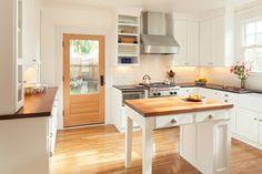 Craftsman u-shaped enclosed kitchen idea in Portland with a farmhouse sink