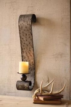 Wrought iron candle wall sconce with clear glass votive holders. Product: Wall sconce ...