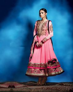 An Elegant layered ensemble in 'anarkali' style  and pink palette.Delicate gold embroidery and wine colored border.fabric used is chiffon and georgette.