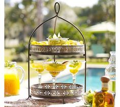 i love margaritas...must get this margarita stand from pottery barn!