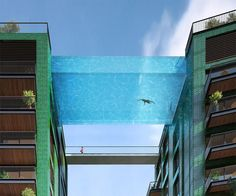 "A glass-bottomed swimming pool called ""Sky Pool"" that will bridge two buildings in Embassy Gardens' new Battersea development. This Swimming Pool"