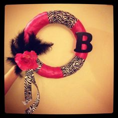 Hot pink and zebra print satin wreath with feathers and flower