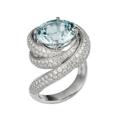 "Brides.com: Unique Engagement Ring Settings ""Trinity de Cartier"" aquamarine and diamond 18K white gold engagement ring, price upon request, Cartier  See more Cartier engagement rings.Photo: Courtesy of Cartier"