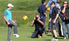 Rory McIlroy (left) and Wayne Rooney hada kickaround while filming an advert for Nike