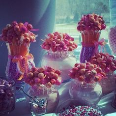 Cake pops bouquet displayed on a candy table. www.cakeballers.com #thecakeballers #cakeballers #cakeballer #cakepops #bouquet