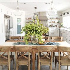 Beautiful White kitchen and rustic table and chairs | Heather Bullard