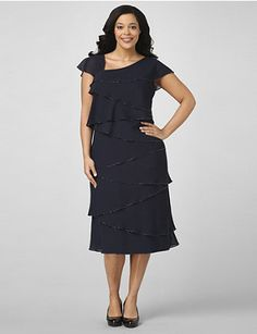 Bead accents complete the tiered trim on this alluring, chiffon dress. Sleeveless style is finished with fluttering, draped sleeves. Ruffle hem offers a feminine design. Catherines plus size dresses are expertly designed to flatter your figure. outlet.com