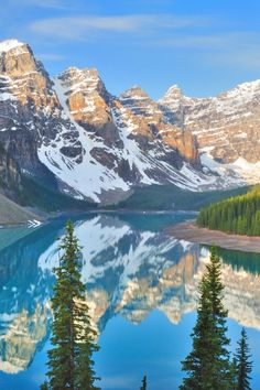 Located in Banff National Park in Alberta, Canada, Moraine Lake is one of the most recognizable lakes in the world. Make sure you hire a canoe if you visit, it's one of the most peaceful experiences you'll enjoy in Parc National De Banff, National Parks, Scenery Pictures, Nature Pictures, Places To Travel, Places To See, Landscape Photography, Nature Photography, Road Trip Usa