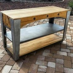 This beautiful piece was made with recycled materials and re-imagined into a rolling kitchen island. The top is a salvaged antique factory mold comprised of solid Poplar butcher block.   Custom welded frame on iron casters.  This design is made to order