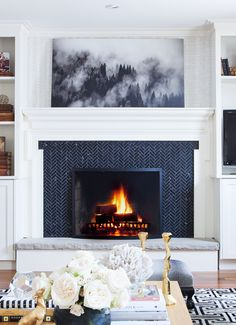 A fireplace with a herringbone tile pattern? LOVE