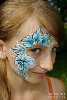 Blue flowers. Face paint by Tanya Maslova.