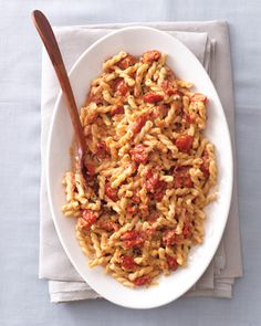 "GEMELLI WITH SLOW-ROASTED CHERRY TOMATOES AND CREAM The secret to this divinely rich sauce? Cherry tomatoes cooked low and slow in the oven, which reduces the natural juices and intensifies flavor and sweetness. ""By the time they're done roasting, you can practically eat them like candy,"" says Domenica Marchetti, author of the new book The Glorious Vegetables of Italy ($20; amazon.com). ""The tomatoes are also amazing alongside grilled veal, lamb, or chicken."""