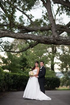 Bride and groom in a stunning outdoor setting. Love the beautiful oak tree! Meggie & Kevin's Hayfields Country Club wedding by Charlotte Jarrett Events