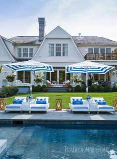 Double chaises with a shared table create a comfortable, social environment around the pool. - Photo: John Bessler / Design: Denise Rinfret and Missy Rinfret