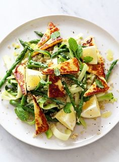 It is a wonderful time of year when both asparagus and zucchini are in season. They are both fantastic in salads. I've partnered them with salty, pan-fried halloumi and lots of fresh mint. Brilliant as a lunch salad or as a side to barbecue feasts