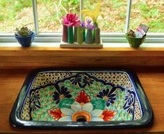 He and his wife added some beautiful touches they could both appreciate like this gorgeous ceramic sink.