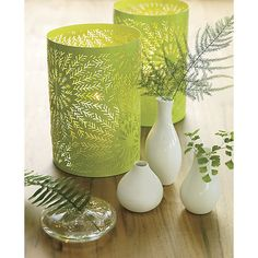 Shop 3-piece trio vase set.   Handmade in brite white porcelain, three mini vessels host blooms in sculptural composition.  Organic shapes—two glossy, one matte—arrive ready to give in a giftable box.