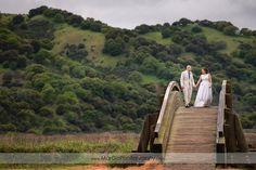 bride and groom walking on the bridge at Martinez Regional Shoreline