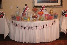 """This was the candy table at my wedding, the sign says """"How sweet it is"""" and the candy we used was all very colorful - we got most of the glass containers from the dollar store! Huge hit at the wedding, and we had chinese to-go boxes (mini) in our wedding colors so guests could take the candy home with them!"""