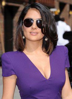 Salma Hayek cleavage in a low cut purple dress