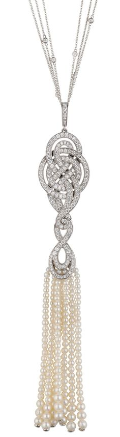 A pendant from Garrard's Entanglement collection with a delicate bead tassel of pearls below a gold and diamond knot.