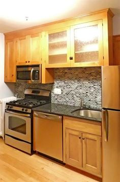 I installed a new cabinet over the sink and range, new tile backsplash, and new appliances. Uncovered original wood flooring and refinished along with original cabinets. New granite countertop was installed.
