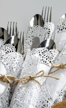 A doily can add a rustic touch, especially when combined with twine. Wrap cutlery with a doily instead of a napkin for a presentation that will definitely stand out.