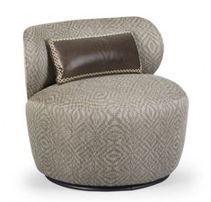 Built for conversation, the low-backed Margot Swivel Chair turns on a hidden swivel mechanism. The charming little retro chair comes in fabric or leather upholstery. #austincollection #arthomefurnishing #chair #swivelchair #livingroom #livingroomfurniture