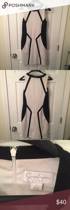 Black and White Color-block Dress Black and white geometric tank top dress. Two layers - 73% Polyester, 23% Rayon, 4% Spandex outer layer and 100% Polyester lining. High neckline. Beautiful dress ready for a new home! Jessica Simpson Dresses