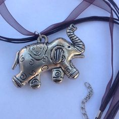 Elephant Necklace Silver tone on a brown organza ribbon. New! Jewelry Necklaces