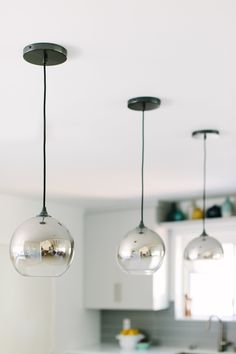West Elm ombre pendants dot the island.