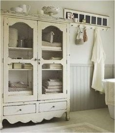 Love the DIY job this creative home decorator has done on this old armoir! looks fantastic in this French style bathrrom