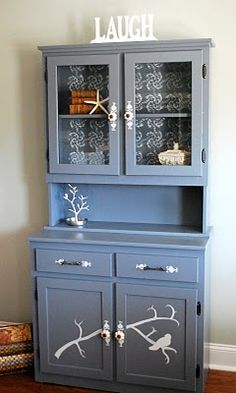 I have a hutch that I don't really like.  Maybe it just needs a coat of paint and a cool wallpaper for the back.