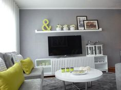 A gray family room enlivened by green
