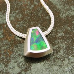 Australian opal pendant in sterling silver by TheHilemanCollection on Etsy https://www.etsy.com/listing/41830646/australian-opal-pendant-in-sterling